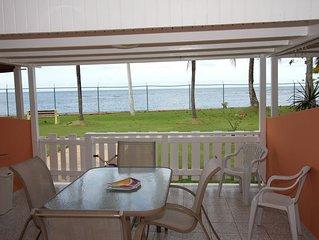 Best beachfront Value!!! Beautiful villa next to Embassy Suites sleeps 1 to 6