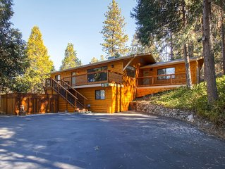 This 4 bedroom, 3 bath log style home has it all