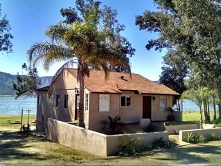 Live on the lake with your own private beach. Tiki Lake House has tropical theme