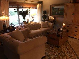 Lovely King Suite. Full Bath, Livingroom, Diningroom, Kitchen, Hot Tub, Laundry