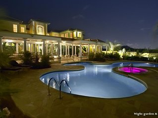 luxury mansion style villa with tropical garden and lagoon style pool