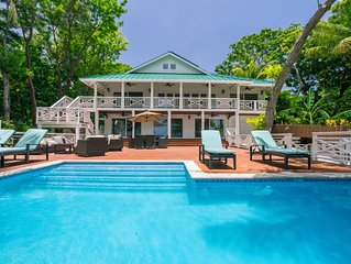 Ultimate Beachfront home w/ Boat, Pool, Paddleboards, Private Dock, & more