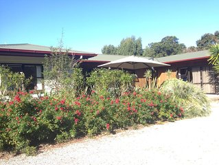 Guest wing in beautiful sheltered garden close to beach