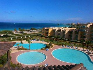 BEACHFRONT - EAGLE BEACH - OCEANIA RESORT - Tropical Penthouse 1BR condo - BG532