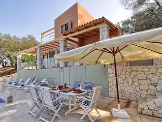 Luxury villa with private pool next to Avlaki Beach, only two minutes away!