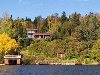 Large, modern lake-front chalet with stunning view. Sauna & jacuzzi