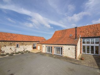 A wonderfully light and spacious recent barn conversion overlooking farmland