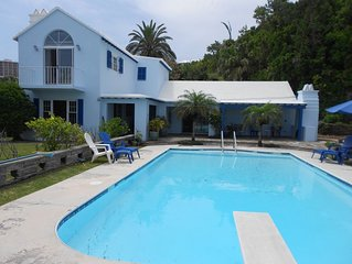 Two-bedroom cottage with lovely pool - central, near beaches, great location!