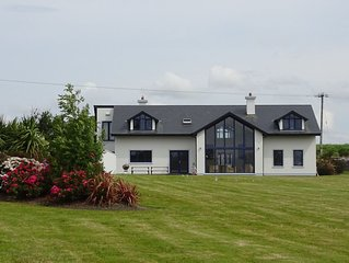 Spacious modern home, on 1 acre, overlooking the sea, just off Wild Atlantic Way