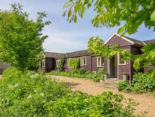 This charming wooden cottage is comfortable and welcoming with an amazing deck a