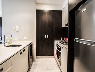 Comfy apartment, next to playground and BBQ area and 3 train stops to the CBD!