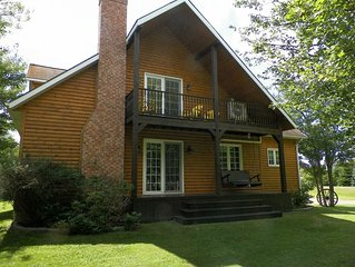 Log home inspired chalet, Centrally located, 1.5kms from Belmont Provincial Park