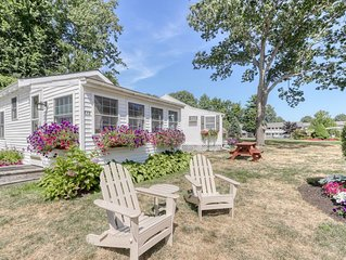 Cottage w/chairs to relax in front and shared sun deck and pool