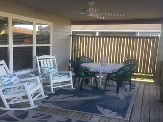 Covered deck with fan provides shade and privacy.