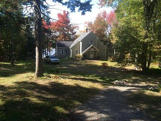 Charming cottage in wooded area, an open floor plan, overlooking tidal water
