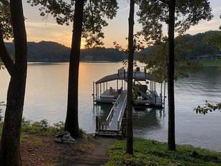 Cute cottage on Lake Lanier with dock and screened porch. NEW to rental market.