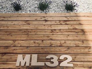 Indipendent suite ML32 con giardino e posto auto riservato