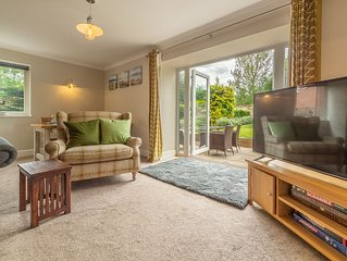 A stylish detached cottage that offers peace, privacy and convenience.
