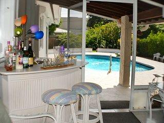 80° Pool, 4 bedrm/3 bath, clean, beach 1.3 mile Screened patio & bar, laundry.