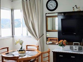 Lindo apartamento, vista para o mar na Ponta da Praia com  Internet WiFi