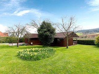 Large Lodge in 3 acres with fabulous Exmoor views, 1.5 mile walk to shops & pubs