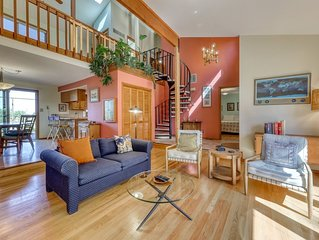 Mid-century home w/ a gas fireplace & large deck w/ beautiful views