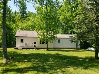 2 bed home secluded on a wooden lot, 5 minutes from Mackinaw City! Sleeps 7-10!