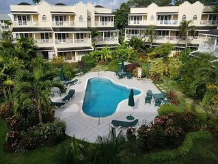 Beautiful Condo with WiFi & Balcony Overlooking Pool & Garden – Steps to Beach