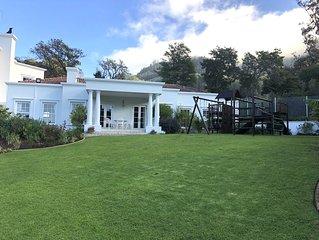 Upmarket holiday accommodation in Constantia wine valley near Kirstenbosch garde
