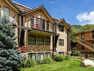 Incredible views in open 2 bedroom condo in Aspen Core! Walk to Gondola.