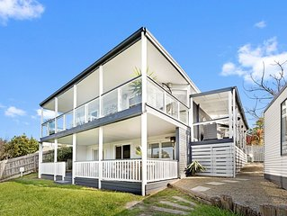 PENINSULA RETREAT beach house with views & a pool