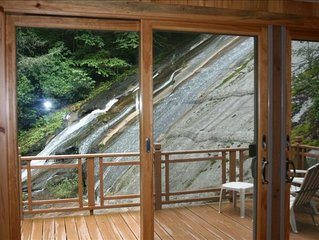 Unique Waterfall House Nestled in Mountains