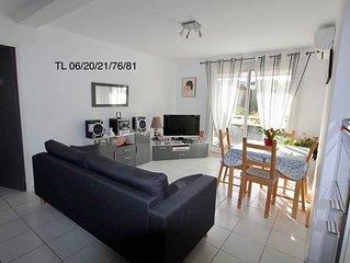 Coquet appartement climatisé ,dans quartier résidentiel à 200m de la plage