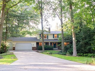 Spacious home with private tennis court, less than 1 mile from Lake Michigan