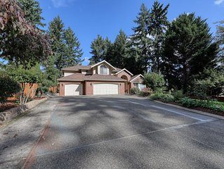 Spacious house w/basketball court surrounded by trees & great location!