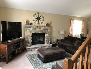 Large creek side home with access to resort amenities!