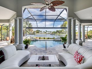 Elegant gulf access home with beautiful canal view, heated pool & large lanai