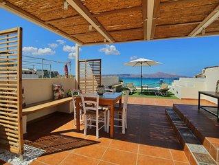 Floor apartment with superb roof terrace, next to Almirida sandy beach
