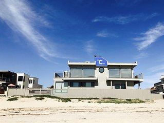 ***OCEANFRONT HOME..SAND AT YOUR FEET... FRONT ROW BEAUTY SLEEPS 8!***