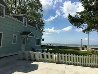 Lake Front Nautical Themed Home with Private Yard & Sandy Bottom Water Access!