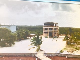 Ocean front Rustic Home With 115 feet of  Pristine  Caribbean Beach with Dock