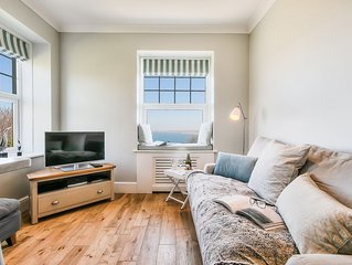 NUMBER SEVEN. Stylishly refurbished apartment with stunning sea views.