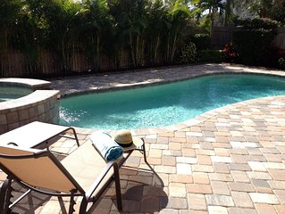 *WALK TO VANDERBILT BEACH*  Newly built and furnished with private pool/spa!