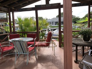 Canal Home, 2BR/2 BA/Heated Pool, Hot tub, Tiki Hut, Courtyard, Great Locale,