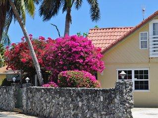 Private villa set behind coral wall, ocean views