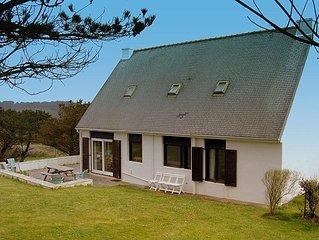 House sleeps 9.   Sea views.   WiFi.    300 yds sandy beach   large garden.