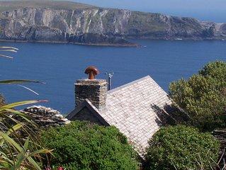 Beautifull stone cottage on Mizen Head overlooking sea and beaches
