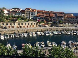 Precioso apartamento con vistas sobre el puerto deportivo en el centro Llanes.