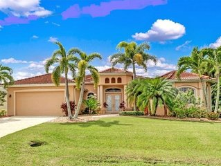 Villa BlueWaters, Waterfront luxury with gulf access, pool/spa, dock/tiki & boat