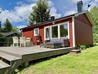 Idyllisches Ferienhaus bei Orkelljunga, Sonnenterrasse, Kaminofen, Walder & Seen